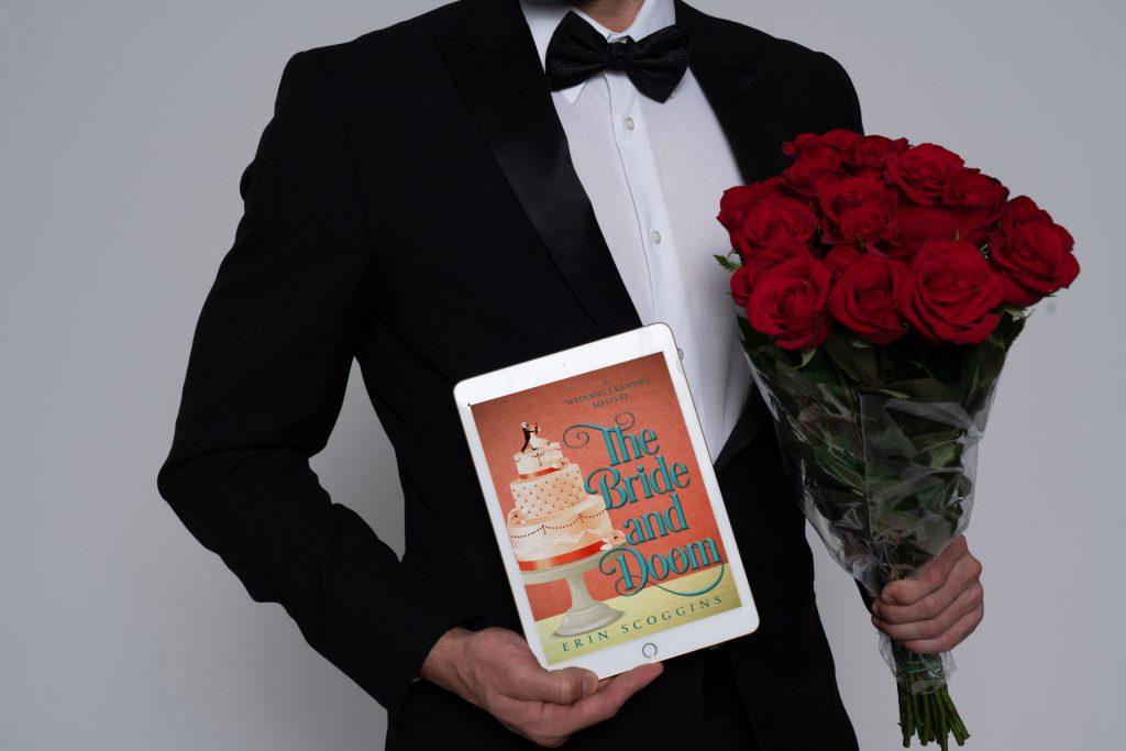 Man in tuxedo holding ebook